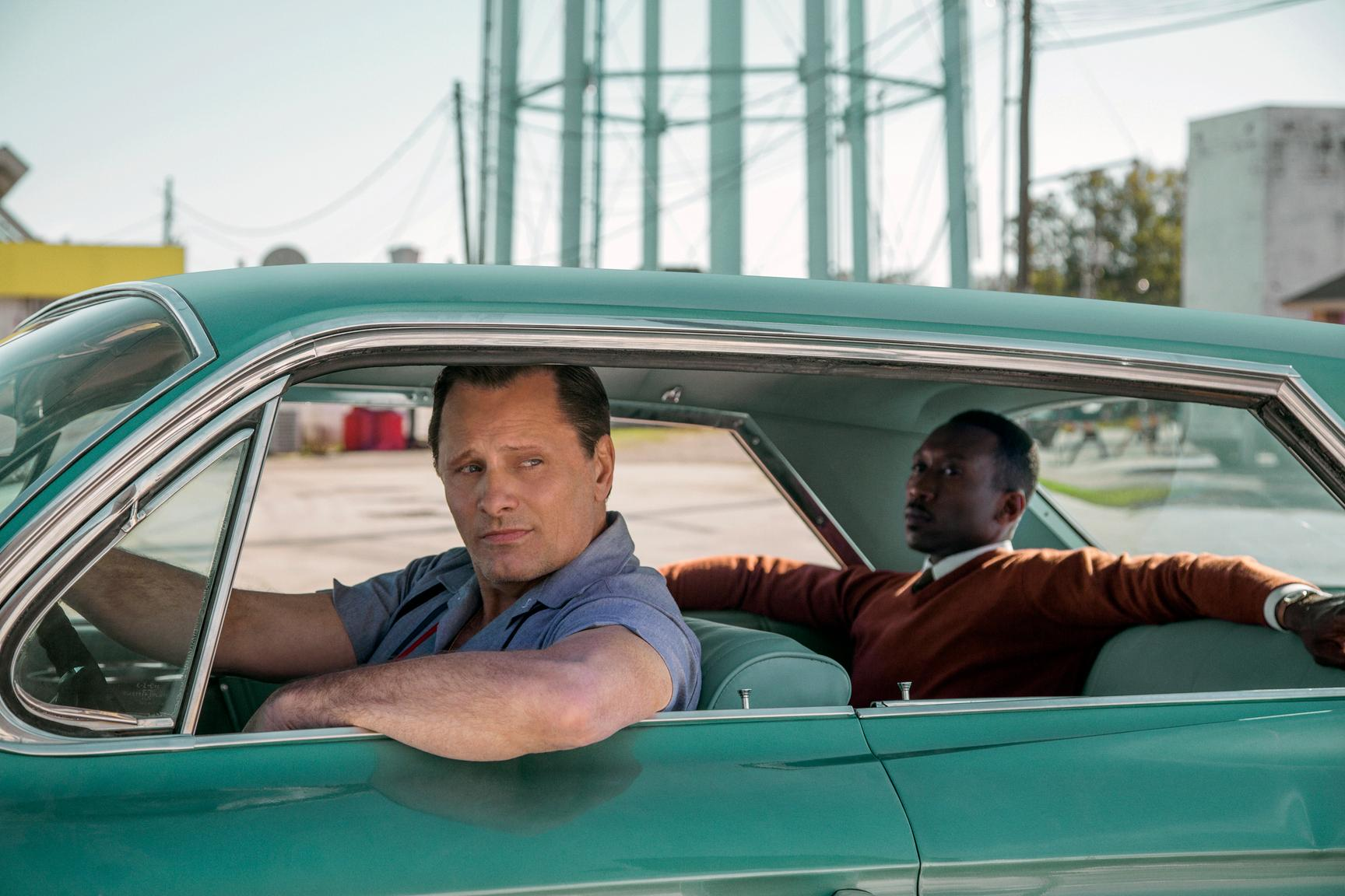 "This image released by Universal Pictures shows Viggo Mortensen, left, and Mahershala Ali in a scene from ""Green Book."" On Tuesday, Jan. 22, 2019, Mortensen was nominated for an Oscar for best actor for his role in the film. The 91st Academy Awards will be held on Feb. 24. (Patti Perret/Universal Pictures via AP)"