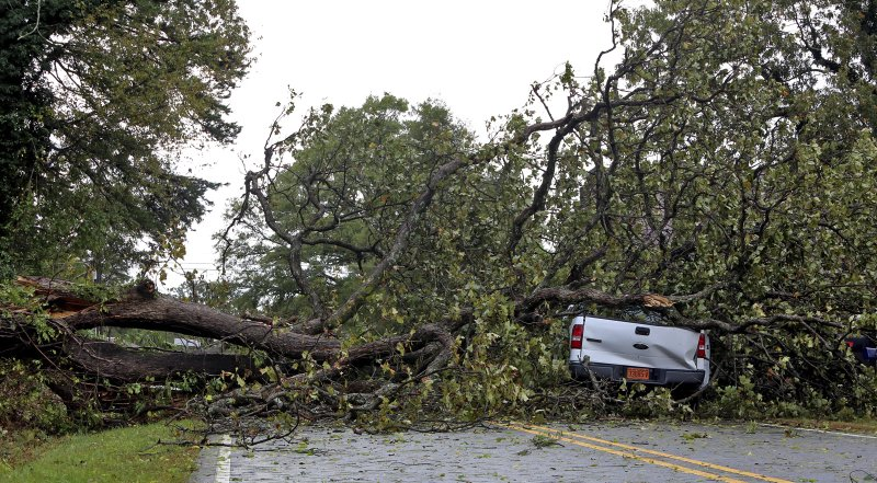 A tree rests on a truck after being blown over by storms in Polkville, N.C., Monday, Oct. 23, 2017. The driver, WIlliam Mark Fox, was on his way home to Polkville when the storm hit. Fox left the scene with no injuries, but was taken to the hospital as a precaution. (Brittany Randolph/The Star via AP)<a  href=&quot;https://www.apnews.com/#imageCarousel&quot; target=&quot;_blank&quot;></a><a  href=&quot;https://www.apnews.com/#imageCarousel&quot; target=&quot;_blank&quot;></a><ol></li></ol>