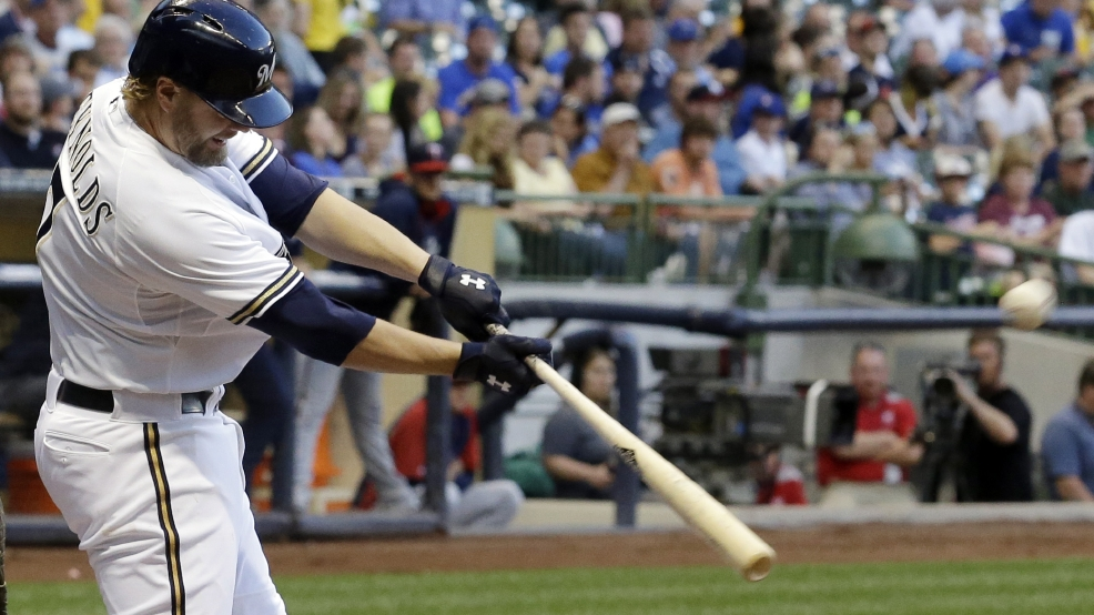 Milwaukee Brewers' Mark Reynolds hits a two-run home run during the fifth inning of a baseball game against the Minnesota Twins, Monday, June 2, 2014, in Milwaukee. (AP Photo/Morry Gash)