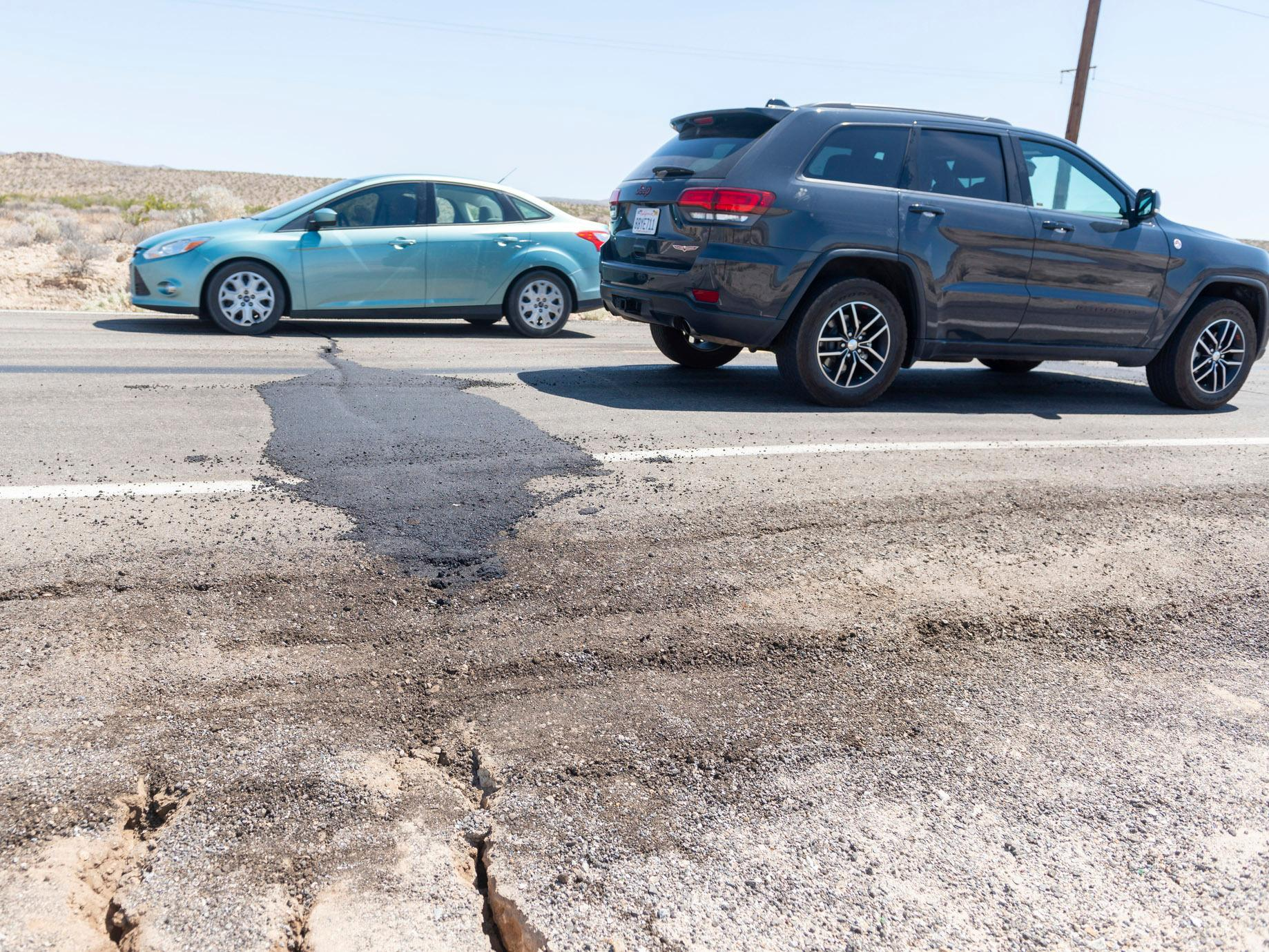 Traffic drives over a patched section of Highway 178 between Ridgecrest and Trona, Calif., on Friday, July 5, 2019. The strongest earthquake in 20 years shook a large swath of Southern California and parts of Nevada on the July 4th holiday, rattling nerves and causing injuries and damage in a town near the epicenter, followed by a swarm of ongoing aftershocks. The 6.4 magnitude quake struck Thursday in the Mojave Desert, about 150 miles northeast of Los Angeles, near the town of Ridgecrest. (James Quigg/The Daily Press via AP)