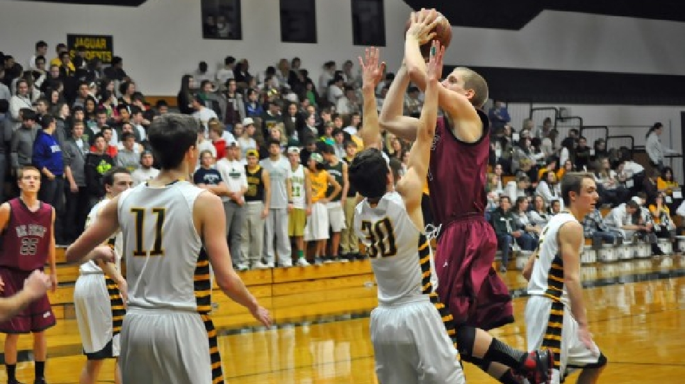De Pere's Brevin Pritzl puts up a shot against Ashwaubenon last season.Pritzl has given Wisconsin a verbal commitment. (Doug Ritchay/WLUK)