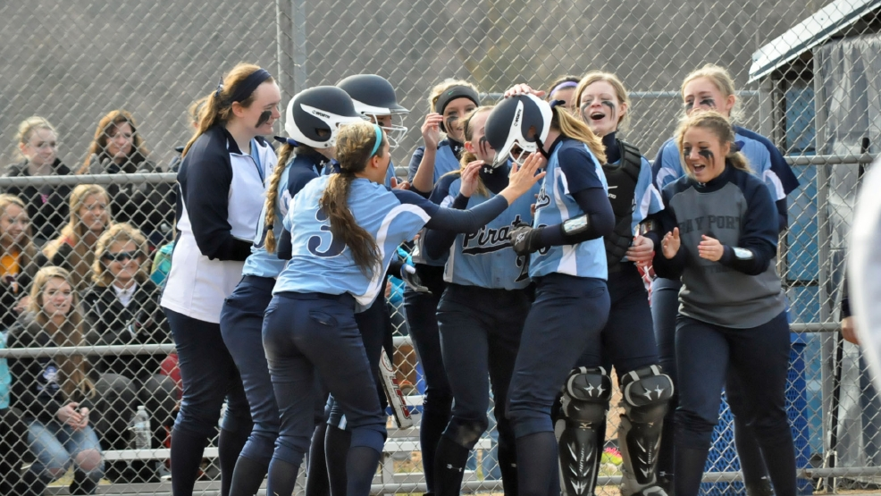 Bay Port players congratulate Alyssa Cooper after she hit a home run during their game Thursday against Pulaski. (Doug Ritchay/WLUK)