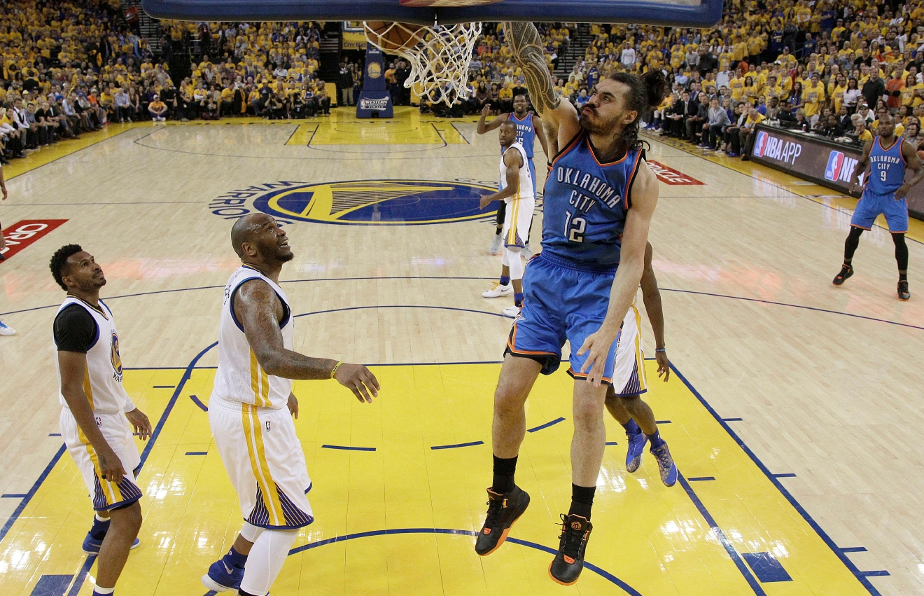 Oklahoma City Thunder center Steven Adams (12) dunks against the Golden State Warriors during the first half of Game 5 of the NBA basketball Western Conference finals in Oakland, Calif., Thursday, May 26, 2016. (AP Photo/Marcio Jose Sanchez)