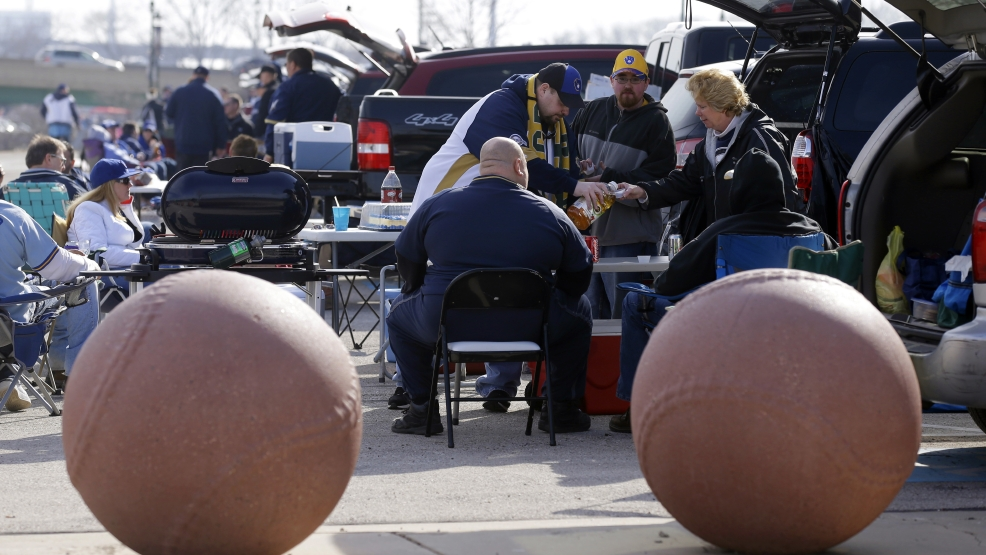 Fans tailgate in the parking lot before the opening day baseball game between the Milwaukee Brewers and Atlanta Braves at Miller Park, Monday, March 31, 2014, in Milwaukee. (AP Photo/Jeffrey Phelps)